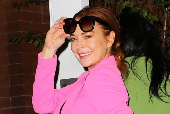 Lindsay Lohan makes a fall statement in a pink pantsuit